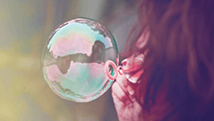 photo of woman blowing bubble