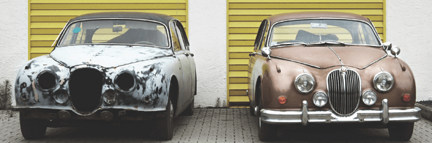 image of two cars parked outside a garage