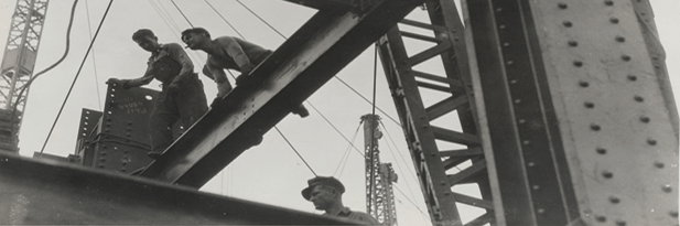 image of workers up cranes